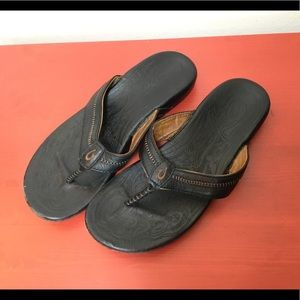 Olukai Black leather flip flops